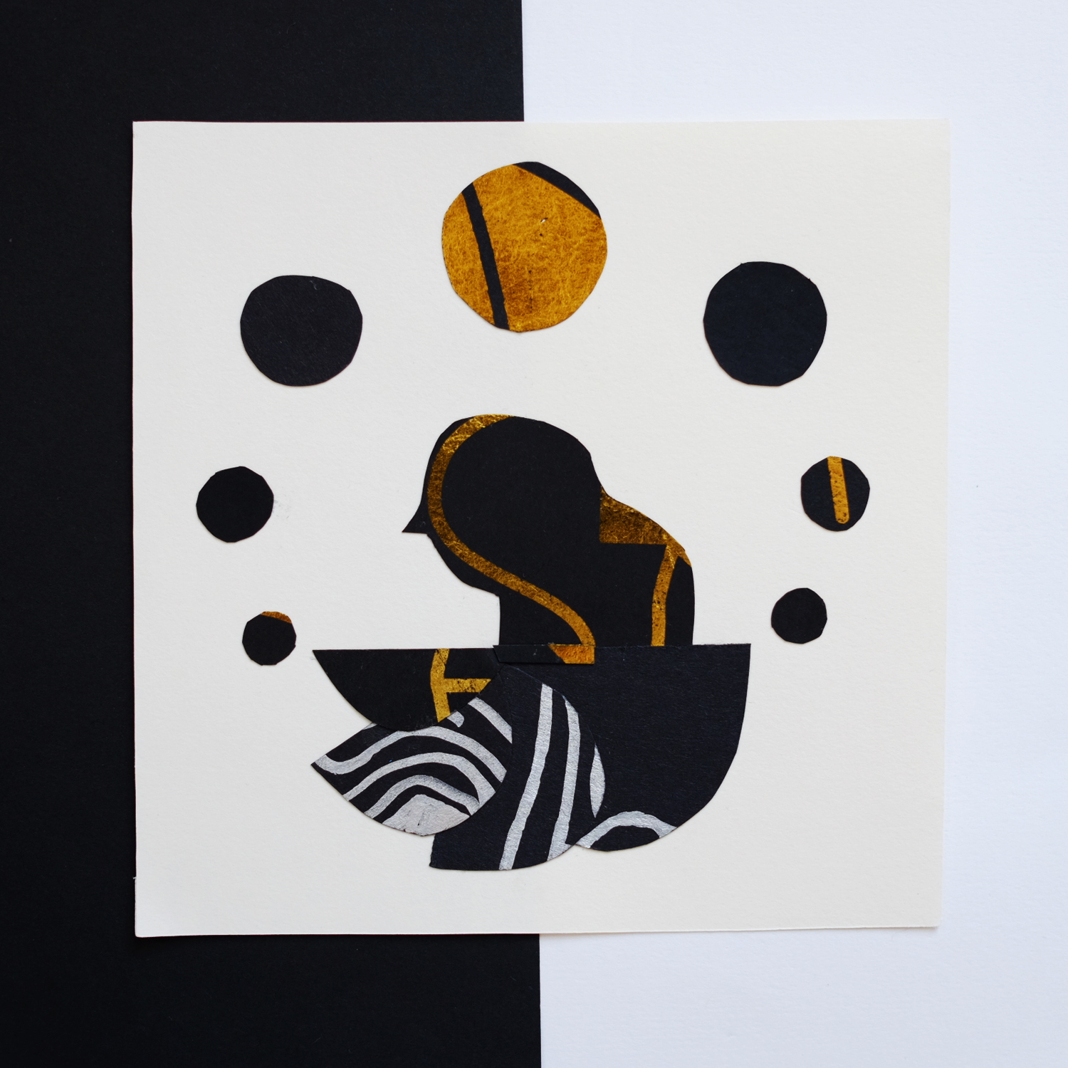 A collage created with black paper covered with gold foil, the image depicts a woman with 7 moons by Monsie illustration Monika Jurczyk