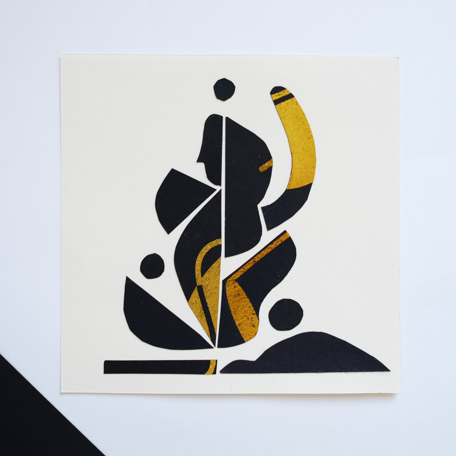 Drawing with scissors, a collage depicting dancing woman / black paper covered with gold foil by Monsie Monika Jurczyk
